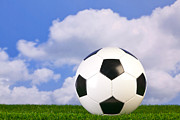 Sports Equipment Posters - Football on grass Poster by Richard Thomas