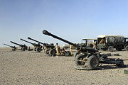 Artillery Metal Prints - Howitzer 105mm Light Guns Are Lined Metal Print by Andrew Chittock