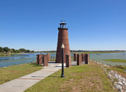 Lake Relections Framed Prints - Lighthouse on Lake Toho at Kissimmee in Florida Framed Print by Allan  Hughes