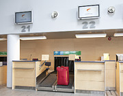 Desk Posters - Luggage at an Airline Check-In Counter Poster by Jaak Nilson