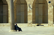 Great Mosque Framed Prints - Man sitting inside the Great Mosque of Aleppo Framed Print by Sami Sarkis