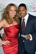 Halo Framed Prints - Mariah Carey, Nick Cannon At A Public Framed Print by Everett