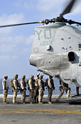 Entering Prints - Marines Board A Ch-46e Sea Knight Print by Stocktrek Images
