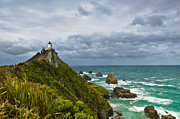 Boundless Prints - Nugget Point Light House and dark clouds in the sky Print by Ulrich Schade