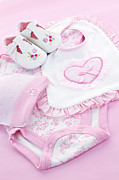 Feminine Photo Framed Prints - Pink baby clothes for infant girl Framed Print by Elena Elisseeva
