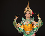 Dancer Art Photo Posters - Portrait of Thai young lady in an ancient Thailand dance Poster by Anek Suwannaphoom