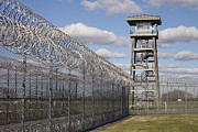 Watch Tower Framed Prints - Prison Fence Watch Tower And Barbed Framed Print by Roberto Westbrook