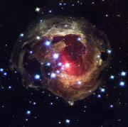 V838 Monocerotis Prints - Radiation From A Stellar Burst Print by ESA and nASA