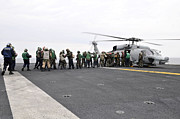 Rotary Wing Aircraft Photo Posters - Sailors And Marines Load Supplies Onto Poster by Stocktrek Images