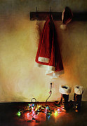 Boots Prints - Santa costume hanging on coat hook with Christmas lights Print by Sandra Cunningham