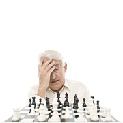 Problems Prints - Senior Man Playing Chess Print by