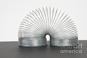Common Item Art - Slinky Toy by Photo Researchers, Inc.
