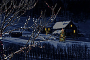 Winter Night Framed Prints - Snowy winter scene of a cabin in distance  Framed Print by Sandra Cunningham