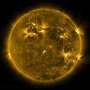 Solar Flares Posters - Solar Activity On The Sun Poster by Stocktrek Images