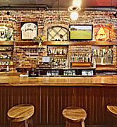 Sports Memorabilia Posters - Stools and Counter in a Sports Bar Poster by Skip Nall