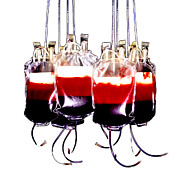 Half Full Framed Prints - Suspended Blood Bags Framed Print by Kevin Curtis