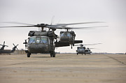 Taxiway Posters - Uh-60 Black Hawks Taxis Poster by Terry Moore