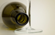 Laying Down Prints - Wine bottle Print by Blink Images
