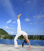 Athlete Photo Acrylic Prints - Woman doing yoga on the beach Acrylic Print by Setsiri Silapasuwanchai