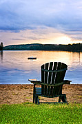 Lake Photos - Wooden chair at sunset on beach by Elena Elisseeva