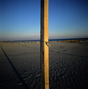 Sandy Beaches Prints - Wooden post Print by Bernard Jaubert