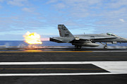 Flight Deck Posters - An Fa-18c Hornet Launches Poster by Stocktrek Images