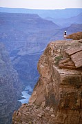 Canyons Photos - A Hiker Surveys The Grand Canyon by John Burcham