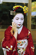 Entertainers Photo Prints - A Kimono-clad Geisha Talks On A Cell Print by Justin Guariglia