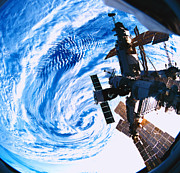 Cloud Prints - A Space Station Orbiting Above Earth Print by Stockbyte