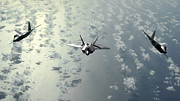 Stealth Prints - A Three-ship Formation Of F-22 Raptors Print by Stocktrek Images