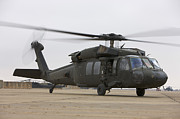 Taxiway Prints - A Uh-60 Black Hawk Taxis Print by Terry Moore