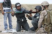 Shoulder-launched Framed Prints - An Afghan Police Student Loads A Rpg-7 Framed Print by Terry Moore