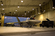 Hangar Prints - An F-22 Raptor Parked In The Hangar Print by HIGH-G Productions