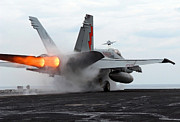 Enterprise Photo Framed Prints - An Fa-18c Hornet Launches Framed Print by Stocktrek Images