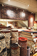 Oriental Rug Prints - Area Rugs in a Store Print by Jetta Productions, Inc