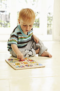 Puzzle Framed Prints - Boy Playing Framed Print by Ian Boddy