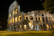 Old Ruin Metal Prints - Coliseum illuminated at night. Rome Metal Print by Bernard Jaubert