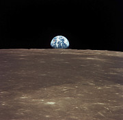 Rising From Earth Prints - Earth Rising Above The Moons Horizon Print by Stocktrek Images