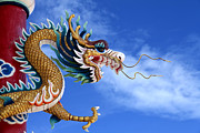 Tao Prints - Giant golden Chinese dragon Print by Anek Suwannaphoom