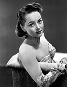 Bare Shoulder Photo Prints - Olivia De Havilland, 1946 Print by Everett