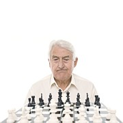 Chess Piece Framed Prints - Senior Man Playing Chess Framed Print by