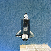 Docking Posters - Space Shuttle Atlantis Poster by Science Source