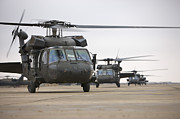 Copy Machine Framed Prints - Uh-60 Black Hawks Taxis Framed Print by Terry Moore