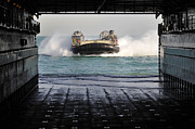Entering Prints - A Landing Craft Air Cushion Prepares Print by Stocktrek Images