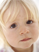 Concern Framed Prints - Baby Girls Face Framed Print by Ian Boddy