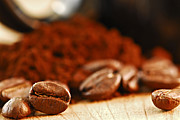 Coffee Table Posters - Coffee beans and ground coffee Poster by Elena Elisseeva