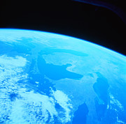 Blue Photo Framed Prints - Earth Viewed From A Satellite Framed Print by Stockbyte