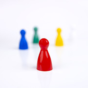Figurine Prints - Game pieces in various colours Print by Bernard Jaubert