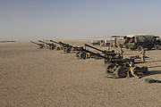 Artillery Framed Prints - Howitzer 105mm Light Guns Are Lined Framed Print by Andrew Chittock