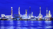 Landscape Of River And Oil Refinery Factory  Print by Anek Suwannaphoom